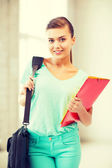 Student girl with school bag and color folders — Foto de Stock
