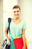 Student girl with school bag and color folders — 图库照片