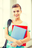 Student girl with school bag and notebooks — Stok fotoğraf