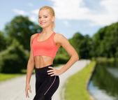 Beautiful athletic woman in sportswear — Stok fotoğraf