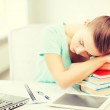 Tired student sleeping on stock of books — 图库照片 #50086009