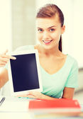 Smiling student girl with tablet pc — Stock Photo
