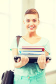 Student with folders and school bag in college — Stock Photo