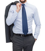 Handsome buisnessman with jacket over shoulder — Stock Photo