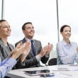 Business team with laptop clapping hands — Stock Photo #50168965