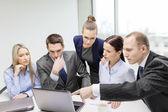 Business team with laptop having discussion — Foto de Stock