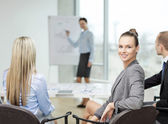 Businesswoman with team showing in office — Stock Photo