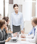 Strict female boss talking to business team — Foto Stock