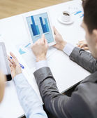 Business team with graph on tablet pc screen — Stock Photo
