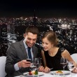 Smiling couple eating main course at restaurant — Stock Photo #50172529