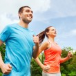 Smiling couple running outdoors — Stock Photo #50174655