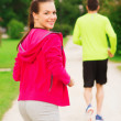 Smiling couple running outdoors — Stock Photo #50174873