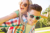 Smiling couple having fun in park — Stock Photo