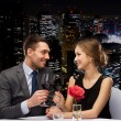Young couple with glasses of wine at restaurant — Stock Photo #50368857