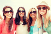 Girls in shades having fun on the beach — Stock Photo