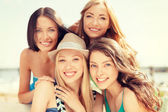 Group of smiling girls in cafe on the beach — Stock Photo