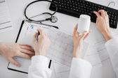 Two doctors prescribing medication — Stock Photo