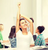 Happy student girl with hands up — Stock Photo