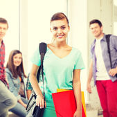 Student girl with school bag and color folders — Foto Stock