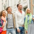 Group of smiling friends walking in the city — Stock Photo #50371001