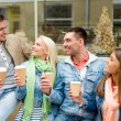 Group of smiling friends with take away coffee — Stock Photo #50372665