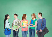 Group of smiling students standing — Stock fotografie