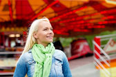 Smiling young woman in amusement park — Stock Photo