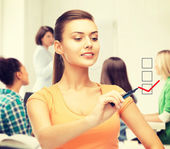 Student drawing checkmark on virtual screen — Stock Photo