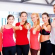 Group of people in the gym showing thumbs up — Stock Photo