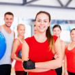 Woman standing in front of the group in gym — Stock Photo #50424115