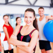 Woman standing in front of the group in gym — Stock Photo #50424141
