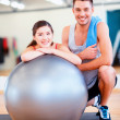 Two smiling people with fitness ball — Stock Photo
