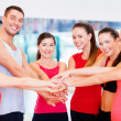 Group of people in the gym celebrating victory — Stock Photo