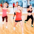 Group of concentrated people exercising in the gym — Stock Photo #50424599