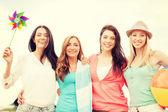 Smiling girls having fun on the beach — Stockfoto