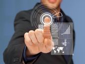 Businessman in suit pressing virtual button — Stock Photo
