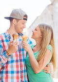 Smiling couple with ice-cream in city — Stock Photo
