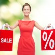 Young woman in red dress with shopping bags — Stock Photo #50495059