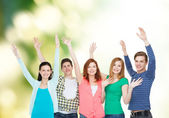 Group of smiling students waving hands — Stok fotoğraf