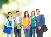 Group of smiling students standing — Stok fotoğraf