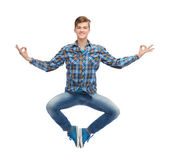 Smiling young man flying in air — Stok fotoğraf