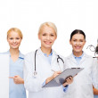 Smiling female eye doctors and nurses — Stock Photo #50539919