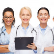 Smiling female doctors and nurses with stethoscope — Stock Photo