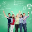 Group of smiling students over green board — Stock Photo #50542643