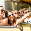 Group of smiling friends traveling by tour bus — Stock Photo #50547177