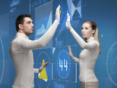 Man and woman working with virtual screen — Stock Photo