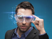 Businessman in virtual glasses — Stock Photo