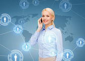 Businesswoman with smartphone over blue background — Stock Photo