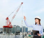 Smiling businesswoman in helmet with clipboard — Foto de Stock