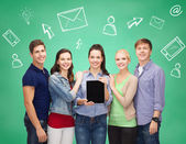 Smiling students with tablet pcs and smartphones — Stock Photo